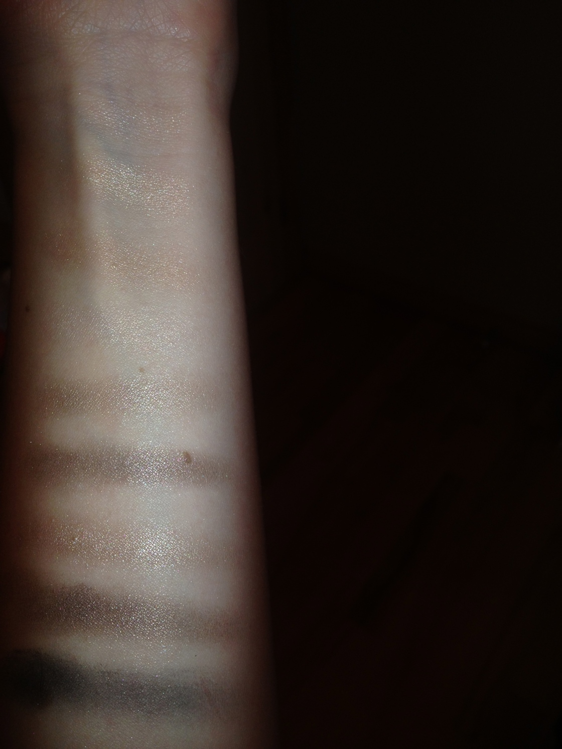 Swatches on bare skin, taken with flash