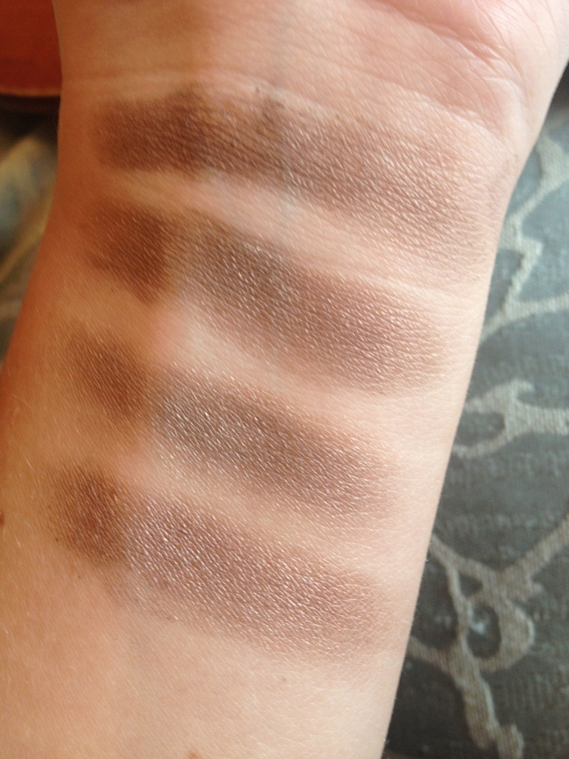 Top to Bottom: Physician's Formula Nude second to farthest left, Urban Decay Hustle, Physician's Formula Nudefourth from left, MAC Satin taupe - taken without flash